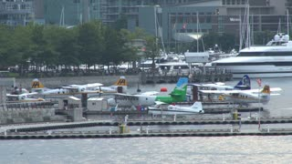 Seaplanes Docked By Boats