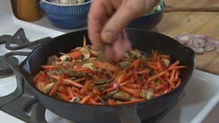 Seasoning and Stirring Vegetables
