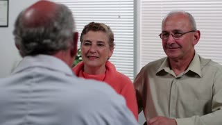 Senior couple in doctor's office, dolly shot