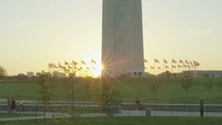 setting sun behind George Washington monument