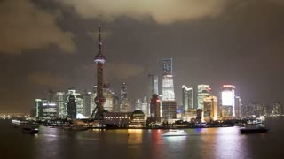 Shanghai night skyline (view along Huangpu River and the Bund), Shanghai, China, Asia, T/Lapse