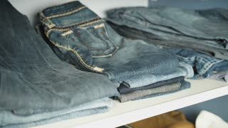 Shelf with jeans in the closet
