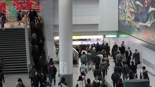 Shibuya District, commuters moving through Shibuya Station during rush hour, Tokyo, Japan, Asia