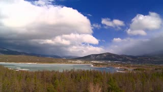 Shifting Clouds Over Mountainside Pond