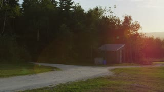 Shining Sunset Over Wooded Park Picnic Tables