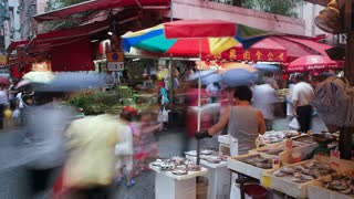 Shoppers browse the traditional Chinese Stalls in Wanchai market, Hong Kong Island, Hong Kong, China, T/lapse