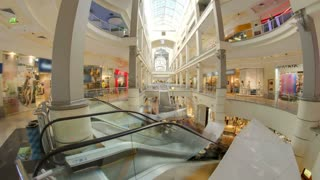 Shopping centre with atrium inside interior on Zemlyanoy Val street, Sadovoye ring in Moscow timelapse hyperlapse fisheye 4K