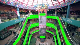 Shopping mall interior with green screen advertising space. Huge trade center with Chroma Key. Crowds of people shopping. Timelapse