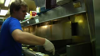 Short Order Cook Flips Burgers With Flame