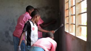 Shot of Children Painting the Inside of a Building