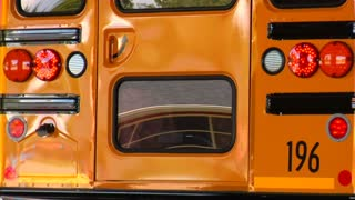 Shot Of Reflections In Rear Of Parked Schoolbus