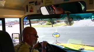 Shot Of Schoolbus Driver Looking And Turning