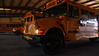 Shot Of Schoolbus Pulling Out Of Garage To Street
