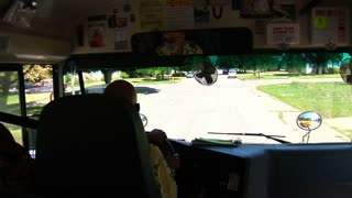 Shot Of Schoolbus Turning From Inside Bus