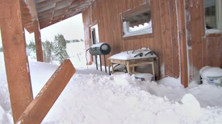Shoveling Snow Drift Off Deck After Blizzard