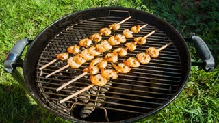 Shrimp grilled over charcoal on the barbecue