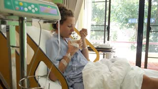Sick Female Patient Eating Soup in Hospital Room