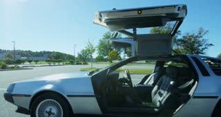 Side of Delorean Body with Gull-Wing Doors Open Slider Shot 4K