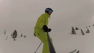 Side view of man skiing down mountain