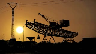 silhouette. cranes industry logistics. time lapse at sunset