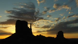 Silhouette Of Man Running With Monument Valley Sunrise