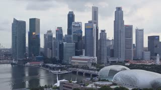Singapore, Marina Centre and business district with Maybank Tower and Republic Plaza, day to night Time lapse