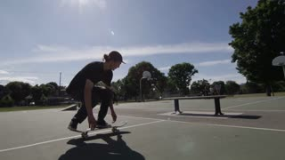 Skateboarder doing tricks on the streets in slow mo