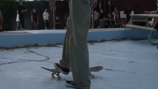 Skateboarder walking with his board