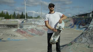 Skater posing with board