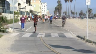 Skaters And Pedestrians At Venice Beach