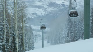 Ski Lift Pods Moving Up Mountain