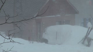 Ski Patrol walks through blizzard