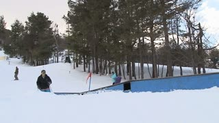 Skier does 180 off table top