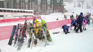 Skiers At Base Of Hill Make Their Way To Lodge