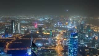 Skyline with Skyscrapers night timelapse in Kuwait City downtown illuminated at dusk. Kuwait City, Middle East. View from rooftop