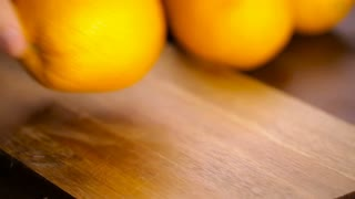 Slices of organic navel orange on cutting board