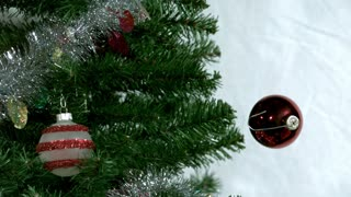 Slow Mo Ornament Floats Onto Tree