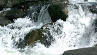 Slow Mo River Rapids Crash Over Rocks