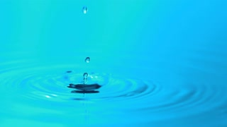 Slow Motion Blue Falling Droplets of Water 7