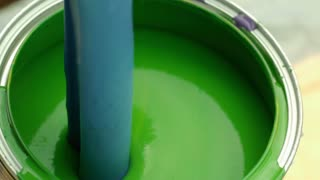 Slow Motion Blue Paint Pouring Into Green