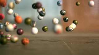 Slow Motion Bouncy Balls Across Floor