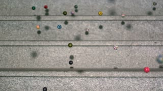 Slow Motion Bouncy Balls Closeup on Marble Steps 1