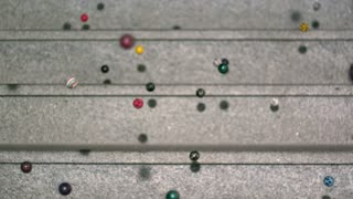 Slow Motion Bouncy Balls Closeup on Marble Steps 2