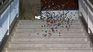 Slow Motion Bouncy Balls Swarming Down Stairs