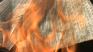 Slow Motion Burning Newspaper