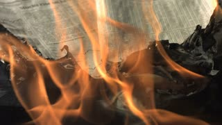 Slow Motion Burning Up Newspaper