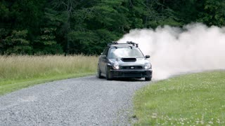 Slow Motion Car Drifting Dirt Path 2