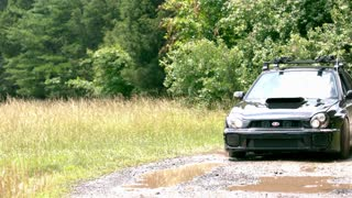 Slow Motion Car Drifting Througb Puddle 1