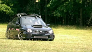 Slow Motion Car Drifting Through Grass 2