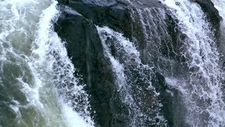 Slow Motion Cascading Waterfalls Tilt Close